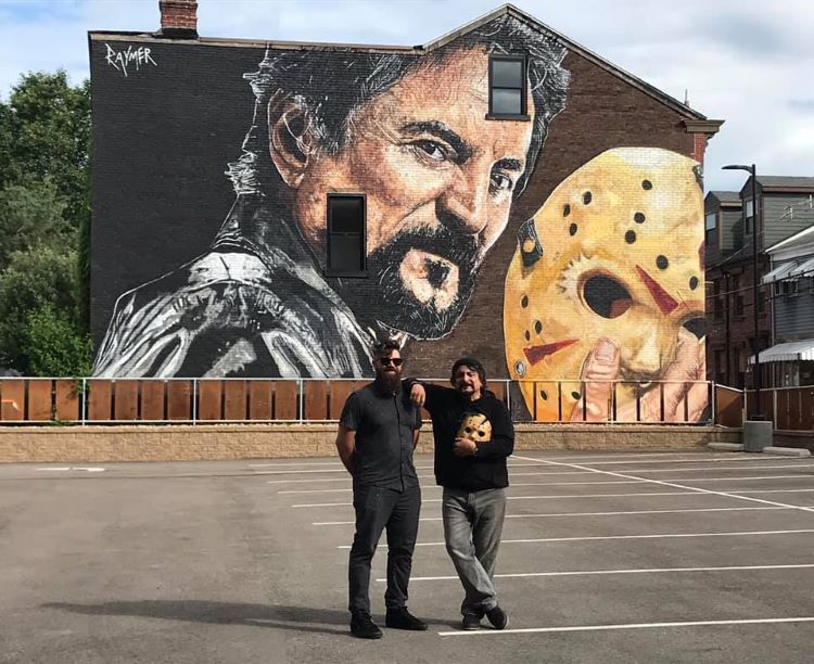Jeremy Raymer paints mural of special effects artist Tom Savini in Lawrenceville