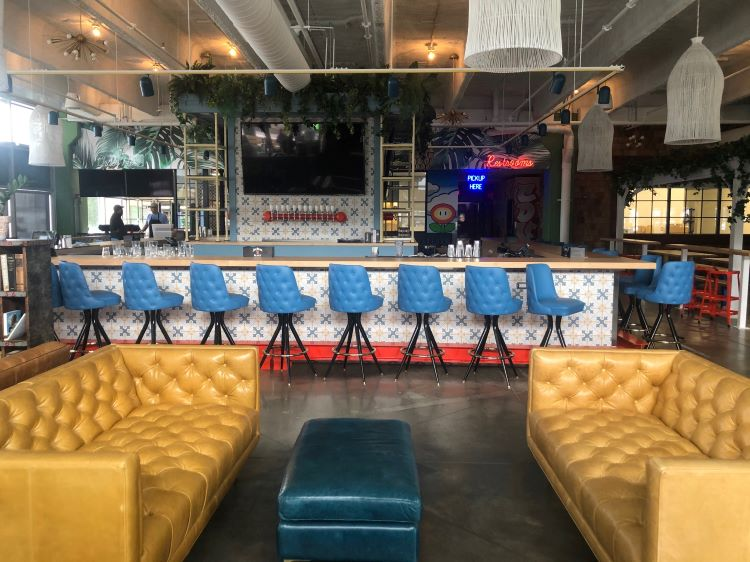 Coop De Ville transforms space in the Strip. Now open for takeout and soon for duckpin bowling, pinball, games and more
