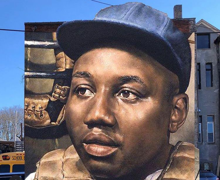 Jeremy Raymer is painting a mural honoring baseball star Josh Gibson