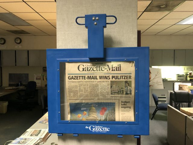 A commemorative newspaper hangs in the Gazette-Mail's newsroom to mark the moment in 2017 when the newspaper won a Pulitzer for its coverage of West Virginia's opioid epidemic. Photo by Andrew Conte